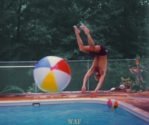 Marty flipping off a beach ball while diving into a Palos Park swimming pool