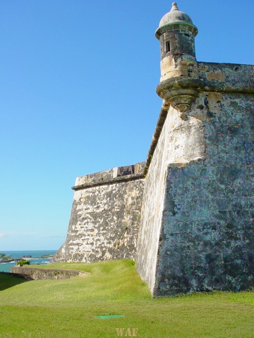 Old San Juan's fortress wall and tower at the water in Puerto Rico
