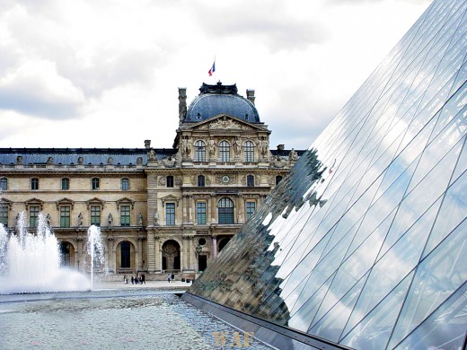 the Pyramid and a fountain, with the Louvre (Paris)
