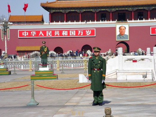 guards in front of the entrance to the Forbidden City, by Tiananmen Square (Beijing, China)