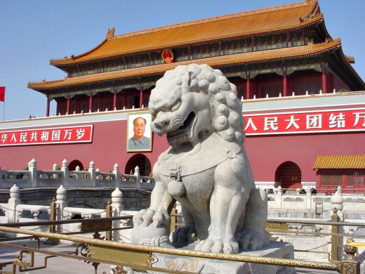 the entrance to the Forbidden City (with a lion statue), by Tiananmen Square (Beijing, China)