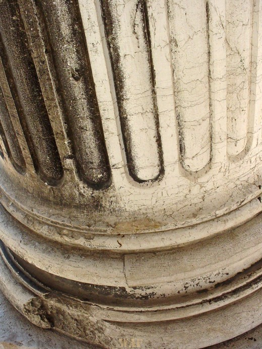 a close-up of a column in Venice (Italy)